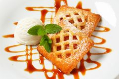Little apricot pies with ice cream Royalty Free Stock Photography