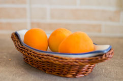 Little apricots basket Royalty Free Stock Photos
