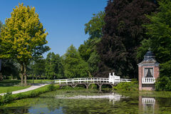 Little arbor and bridge. In park in Holland Royalty Free Stock Photo