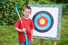 Little archer with bow and arrow Stock Images
