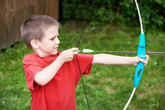 Little archer with bow and arrow Royalty Free Stock Photos