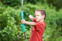 Little archer with bow and arrow Stock Photo