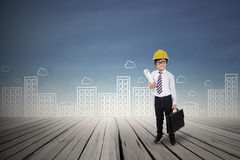 Little architect holding bag outdoor Royalty Free Stock Image