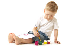 Little artist. Little boy painting sitting on floor Stock Photo