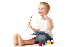 Little artist. Little boy painting sitting on floor stock photography