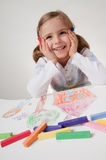Little artist. Happy little girl drawing house and family Royalty Free Stock Photo