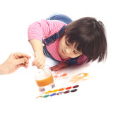 Little artist. Cute little baby painting lying on the floor Stock Photo