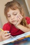 Little artist. Portrait of a little girl painting Stock Photos