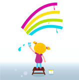 Little artist - child painting Rainbow on the wall Stock Image
