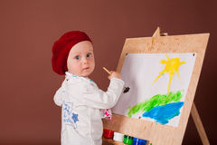 Little artist at easel Stock Photo