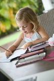 Little artist girl making drawings. Portrait of little girl making drawings royalty free stock images