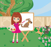 Little artist girl painting dog on large paper canvas Royalty Free Stock Photography