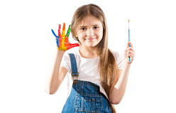 Little artist girl showing painted hands Stock Photo