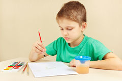 Little artist in green shirt painting colors Stock Photography