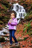 Little artist near waterfall Royalty Free Stock Photos