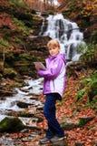 Little artist near waterfall Stock Images