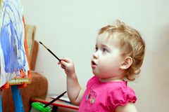 Little artist is painting Royalty Free Stock Image