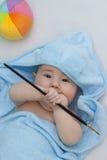 Little artist in towel Stock Image
