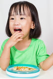 Little Asain Chinese Eating Pizza Royalty Free Stock Photos