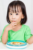 Little Asain Chinese Eating Pizza Stock Photo