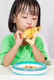 Little Asain Chinese Eating Pizza Royalty Free Stock Photo
