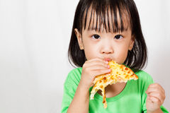 Little Asain Chinese Eating Pizza Royalty Free Stock Photography