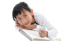 Little Asian artist child drawing on white Royalty Free Stock Photos
