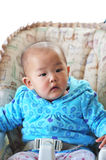 Little asian baby. A little baby sets on high chair Royalty Free Stock Photo