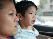 Little Asian baby girl having fun traveling with her mother by car as she learning to tell what she see during the trip. Little Asian baby girl, 33 months old royalty free stock photos