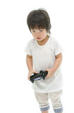 Little  asian baby using video game controller. Stock Photo