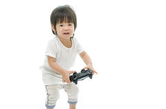 Little  asian baby using video game controller. Royalty Free Stock Images
