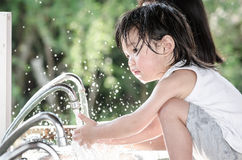 Little asian baby washing hand Stock Photo
