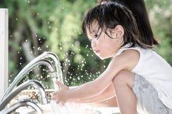 Little asian baby washing hand Stock Photo