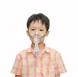 Little Asian boy with asthma using oxygen mask on white backgro Stock Image