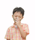 Little Asian boy with asthma using oxygen mask on white backgro Stock Images