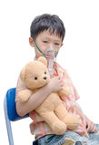 Little Asian boy with asthma using oxygen mask Stock Image