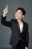 Little asian boy in black suit point up Stock Images