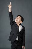 Little asian boy in black suit point up Royalty Free Stock Photos