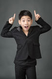Little asian boy in black suit point up Royalty Free Stock Image