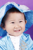 Little asian boy in blue Stock Images