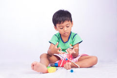 Little asian boy count finger on white Royalty Free Stock Images