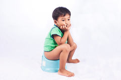 Little asian boy defecate. On white background Royalty Free Stock Photography