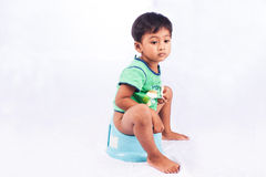 Little asian boy defecate Royalty Free Stock Photo
