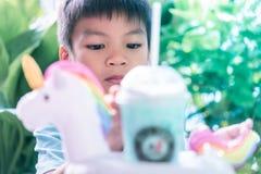 Little asian boy drinking Unicorn milk royalty free stock photo