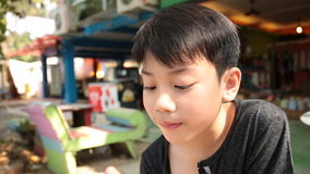 Little Asian boy enjoy with icecream . stock video footage