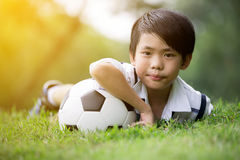 Little asian boy with football at the park Stock Image