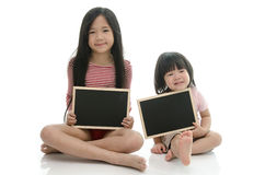 Little asian boy and girl sitting and holding  chalkboard Stock Images