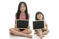 Little asian boy and girl sitting and holding  chalkboard Royalty Free Stock Images