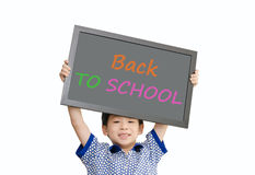 Little Asian boy holding chalkboard over white background Royalty Free Stock Photography