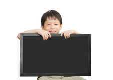 Little Asian boy holding  empty chalkboard Stock Photo